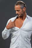 Adult muscular man showing his chest royalty free stock image