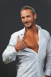 Adult muscular man showing his chest Stock Photography