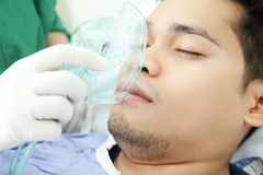 Oxygen Treatment. Adult patient recieving oxygen treatment from a health worker royalty free stock photo