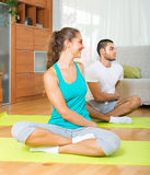 Adult people doing yoga indoor. Adult people doing yoga on mats indoor Royalty Free Stock Image