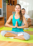 Adult people doing yoga indoor Royalty Free Stock Photo
