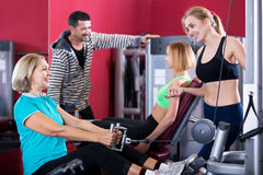 Adult people having strength training in gym Royalty Free Stock Photography