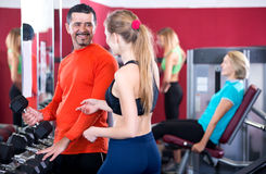 Adult people having strength training in gym. Happy people of different age having strength training in sport club Stock Photography