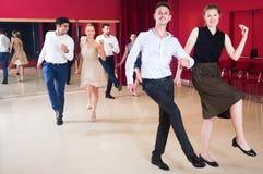 Adult people practicing vigorous jive movements Royalty Free Stock Photo