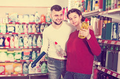 Adult people selecting detergents in the store Stock Photo