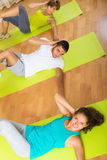 Adult people working in gym Stock Images