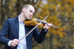 Adult playing at violin Royalty Free Stock Photos