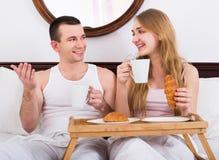 Adult positive couple having healthy breakfast Stock Image