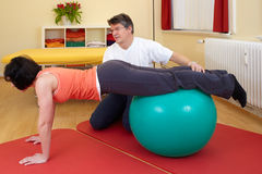Adult practicing poses on exercise ball Royalty Free Stock Images