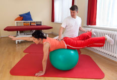 Adult practicing poses on exercise ball Royalty Free Stock Photos
