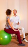 Adult practicing poses on exercise ball Stock Photo