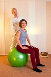 Adult practicing poses on exercise ball Royalty Free Stock Image