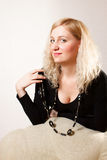 Adult pretty girl in black jacke looking at camera Royalty Free Stock Images