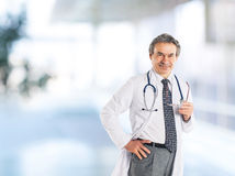 Adult qualified physician diagnostician, with a stethoscope, med Stock Image