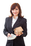 Adult realtor with money and wooden small house,it Royalty Free Stock Photo