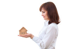 Adult realtor with wooden toy house,it could be Stock Photos