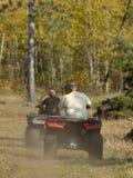 An Adult riding an ATV Stock Images