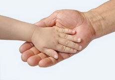 Adult's and baby's hands Royalty Free Stock Images