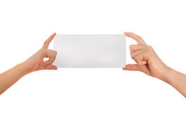 Adult's hand and child's hand holding white paper, cardboard. White background with space for text Stock Photo