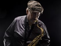 Adult sax player with his instrument. In studio Stock Image
