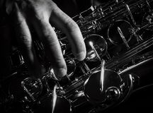 Adult sax player with his instrument. Detailed image Stock Photo