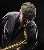 Adult sax player with his instrument. In studio Stock Photos