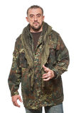 Adult scary man in a camouflage jacket. a Stock Image