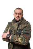 Adult scary man in a camouflage jacket. a Royalty Free Stock Image