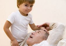 Adult senior. Play about with his grandson Royalty Free Stock Photo