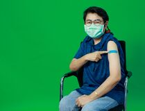 Free Adult Senior Asian Woman Wearing Hygiene Mask Confident Show Shoulder With Bandage Plaster After Getting Coronavirus Of Covid-19 Royalty Free Stock Image - 218383766