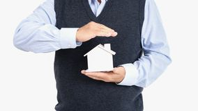 Adult senior old man hold house royalty free stock photo