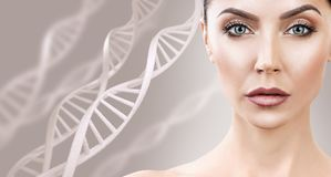 Portrait of sensual woman among DNA chains. Adult sensual woman among DNA chains over beige background. Biochemistry skin concept stock images