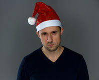 Adult serious man in christmas hat Royalty Free Stock Photos