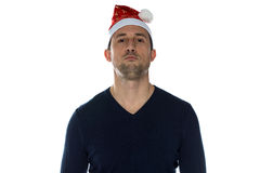 Adult serious man in christmas hat Royalty Free Stock Images