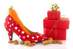 Adult shoe with carrot Royalty Free Stock Photos