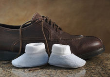 Adult shoe and infant shoes Royalty Free Stock Images