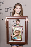 Adult sister holding portrait with her family Stock Photo