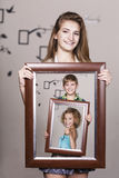 Adult sister holding portrait with her family Stock Image