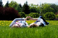Adult sisters in a park Stock Photo