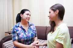 Adult sisters quarrel Stock Photos