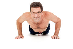 Adult smiling man doing workout pushups isolated Stock Image