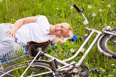 Adult smiling woman laying in the grass Stock Images