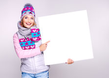 Adult smiling  woman in winter hat holds the white banner Stock Photography