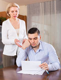 Adult son and senior mother with papers Stock Photography