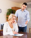 Adult son and senior mother with papers Royalty Free Stock Images