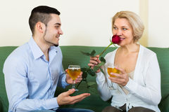 Adult son and senior mother with wine Stock Photos
