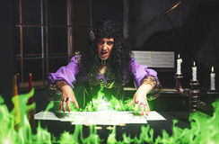 Adult sorceress practising witchcraft. Sorceress practises witchcraft, she is summoning ghosts stock photography
