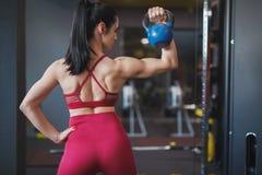 Adult sportswoman lifting kettlebell royalty free stock image