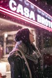 Adult Standing Outside During A Snowfall