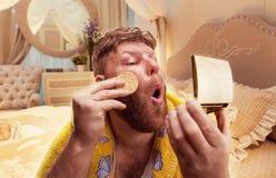 Adult strange man powders himself Stock Image